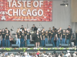 Olga Merediz with members of the Niles North High School Choral Department at the Broadway In Chicago Concert in the Park